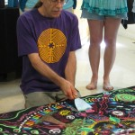 Dismantling the sand mandala(Photo courtesy ofRamona Snow Teo)