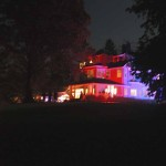 The beautiful main house at CoSM lit up at night.
