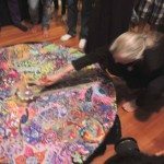 ALex Grey is invited to make the first cut into the sand.